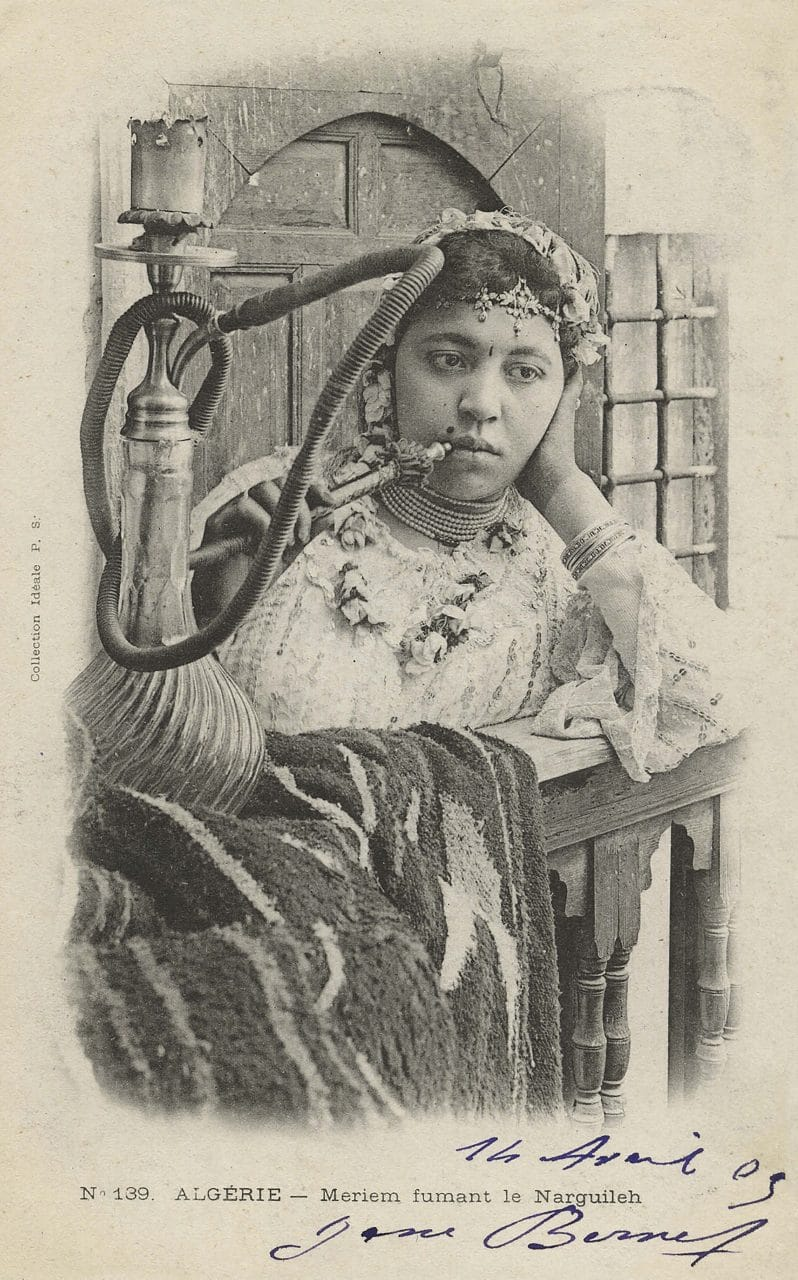 Postcard of an Algerian girl smoking a narghile, early 20th century.