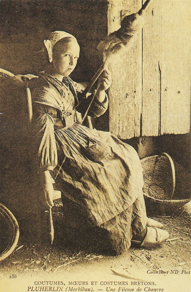 Late 19th century postcard depicting a girl from Brittany (France) making hemp threads.