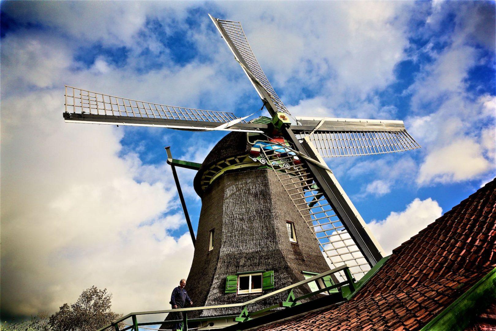 Dutch hempbeater with blue cloudy sky